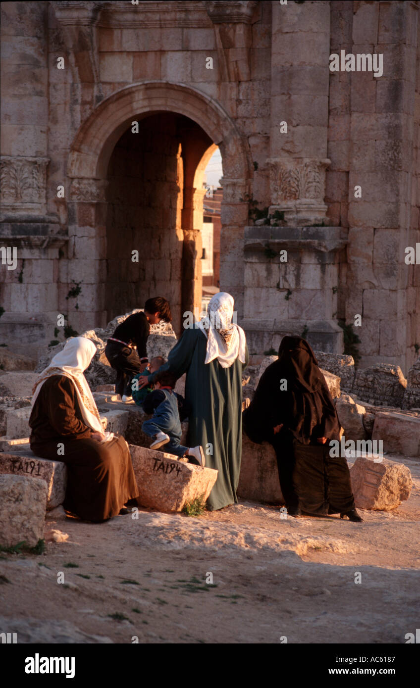 Women and children by the Triumphal Arch in Jerash Jordan - Stock Image