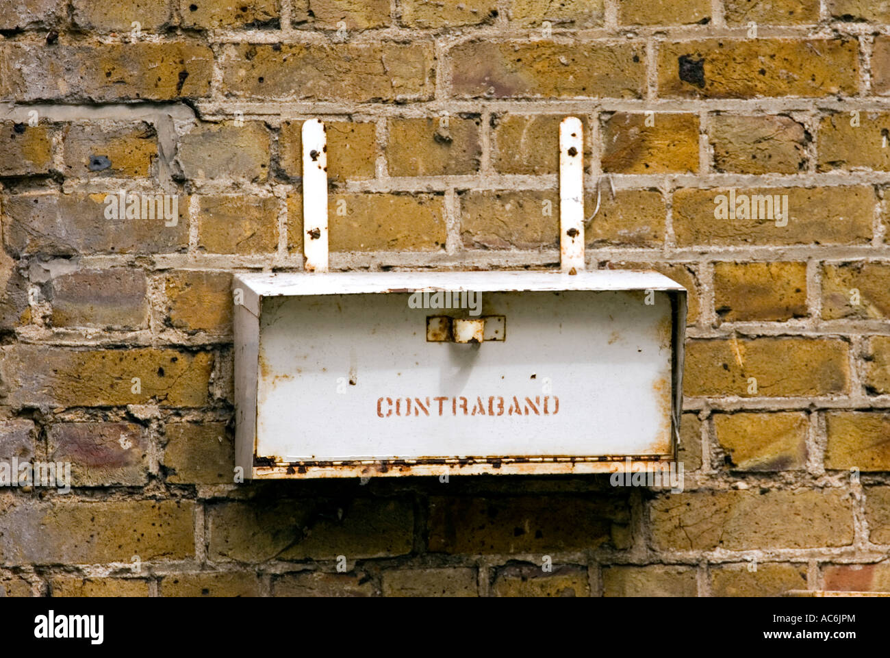 Close-up of contraband box mounted on brick wall,Essex, England,UK - Stock Image