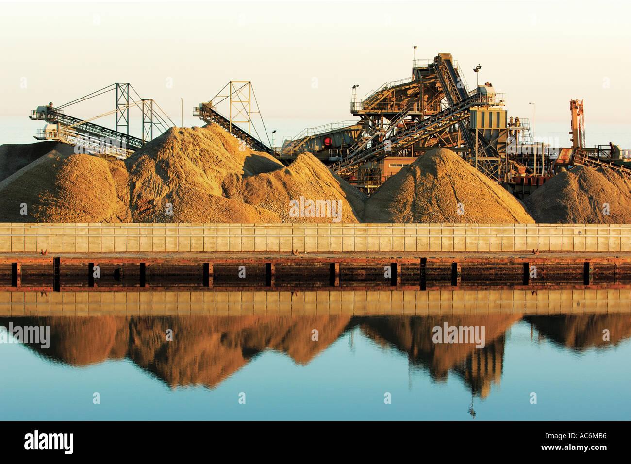 material stockpiles Shoreham harbour Sussex England - Stock Image