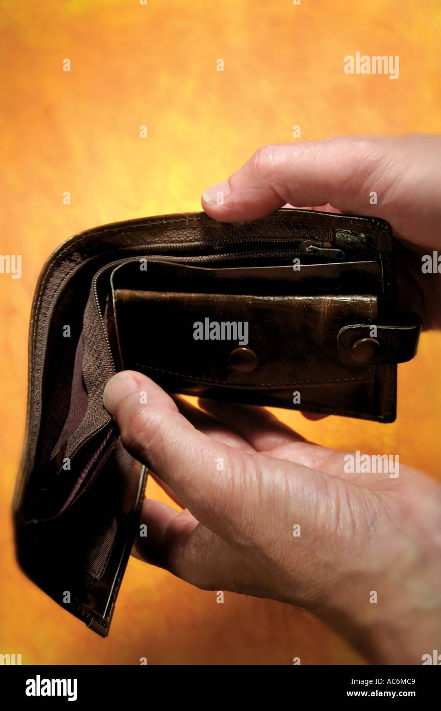 man holding empty wallet Stock Photo