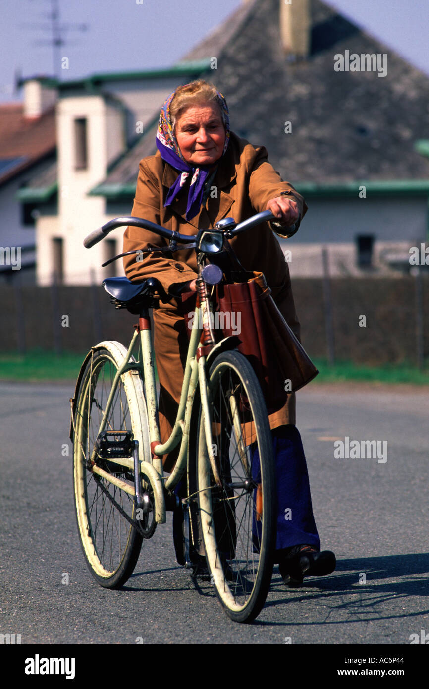 Elderly woman walking with bicycle Czech countryside - Stock Image