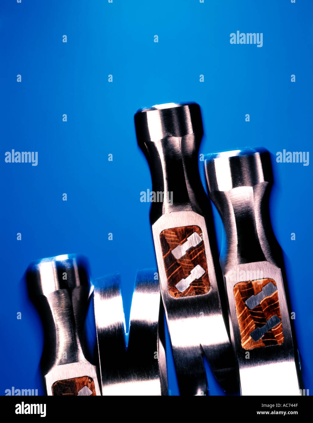 four silver hammers on blue background Stock Photo