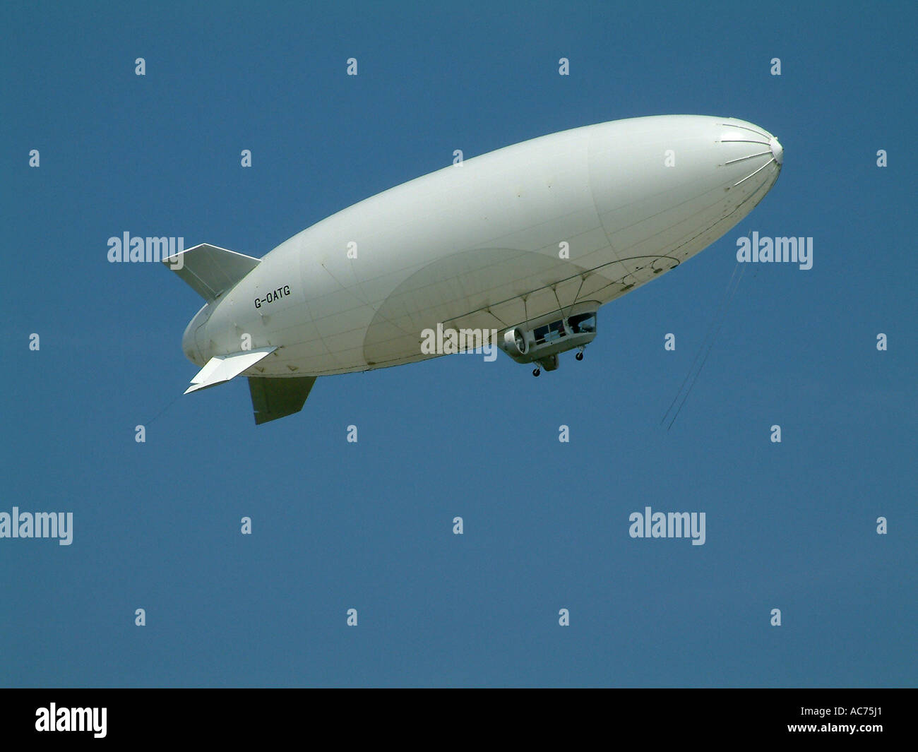 airship flying in clear blue sky Stock Photo