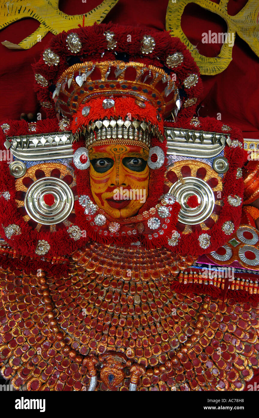 THEYYAM, THE TEMPLE RITUALISTIC DANCE OF MALABAR REGION OF KERALA - Stock Image