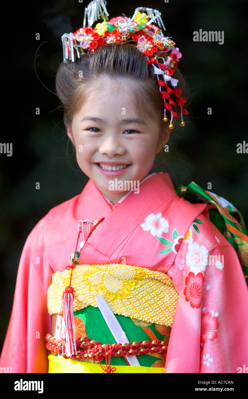 7 year old girl in traditional dress, Tokyo, Japan - Stock Image