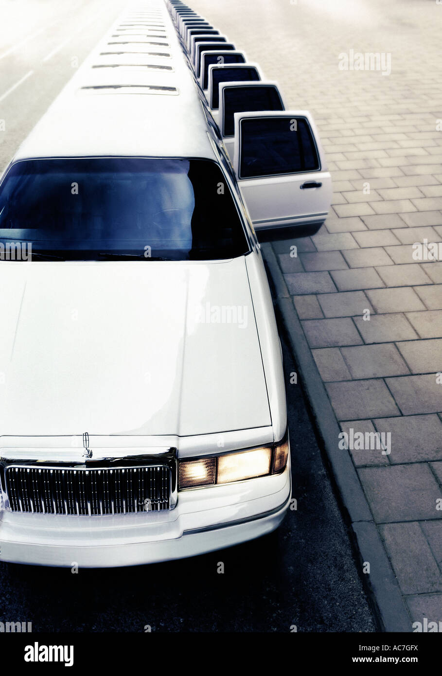 Superstretch white limousine parked at the kerb - Stock Image