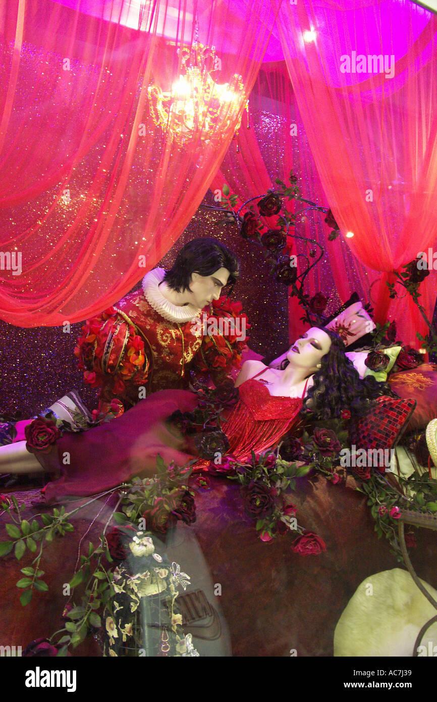 romantic kiss scene from sleeping beauty in Harrods department store christmas fairytale window display london UK - Stock Image