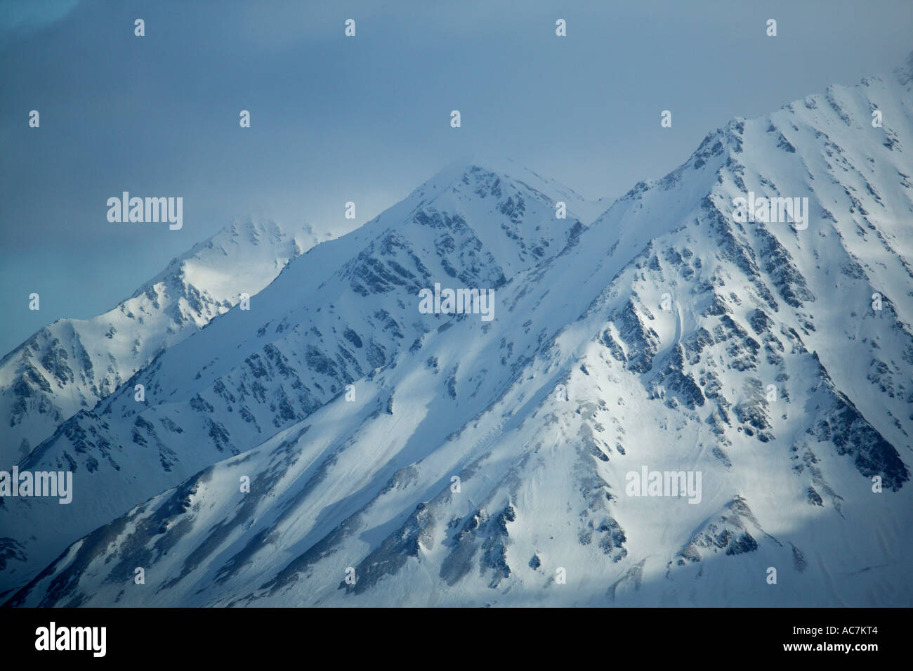 Aerial photograph of snowy mountains on the western side of Spitsbergen, Svalbard region, Norway. Stock Photo