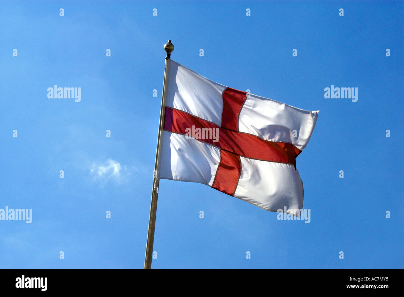 English Flag Flag of St George flying against a blue sky - Stock Image