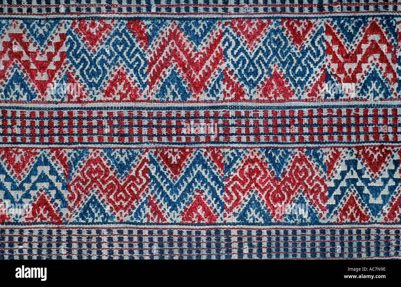 Bhutanese brocaded fabric with supplementary weft brocading Woven on a hip strap loom Bhutan - Stock Image
