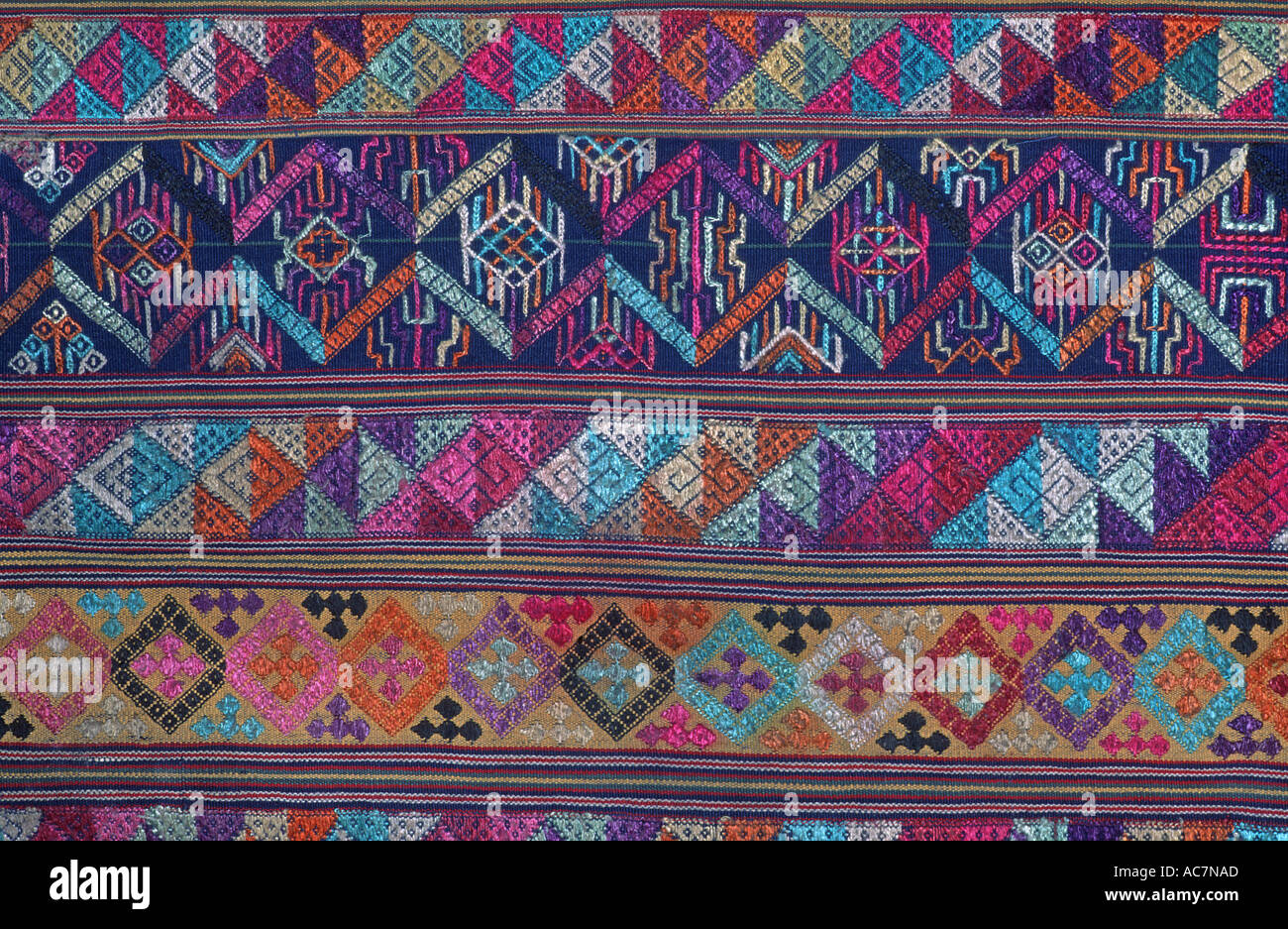 Bhutanese brocaded fabric with silk supplementary weft brocading Woven on a hip strap loom Bhutan - Stock Image