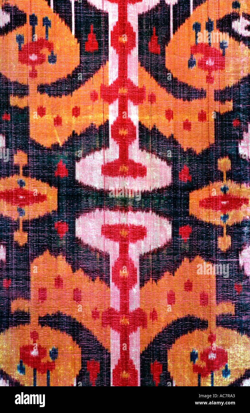 Ikat patterned silk fabric from Uzbekistan A textile tradition practiced by both the Tadjik and Uzbek peoples Central Asia - Stock Image