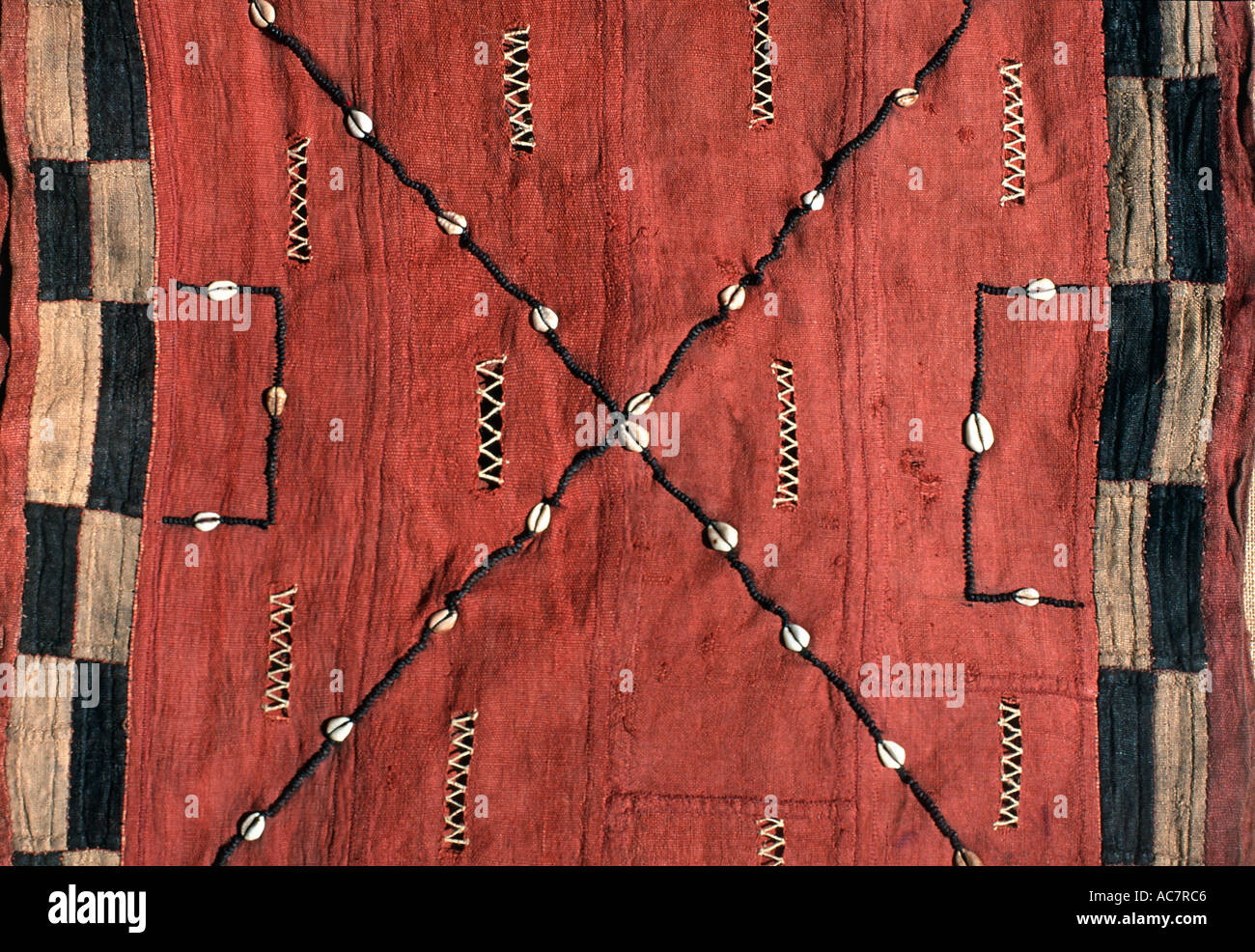 Woven raffia textile from Democratic Republic of Congo formerly known as Zaire Kuba tribe Applique decoration including shells - Stock Image
