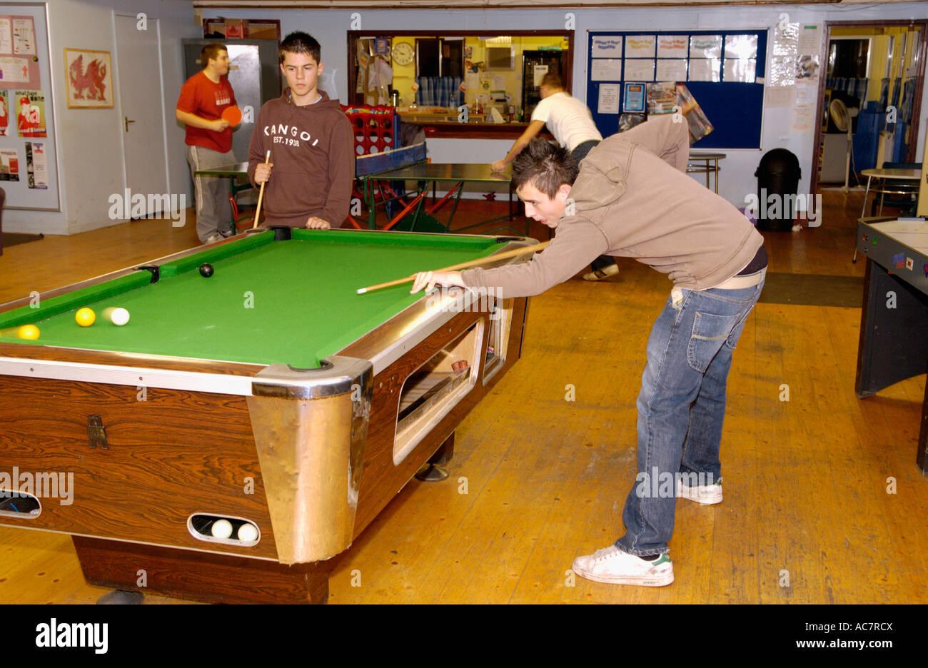 Teens playing billiard