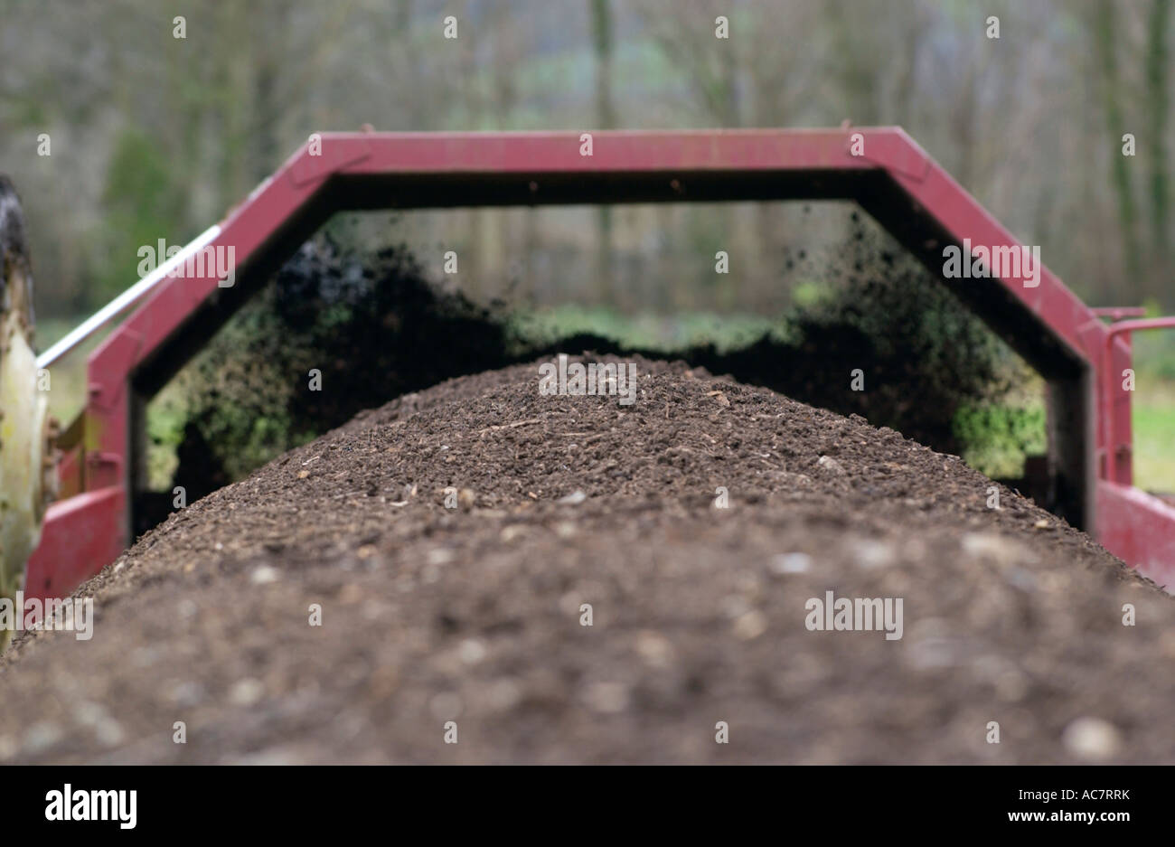 Tractor turning microbial compost heap on Blaen Camel Organic Farm Lampeter Ceredigion West Wales UK - Stock Image
