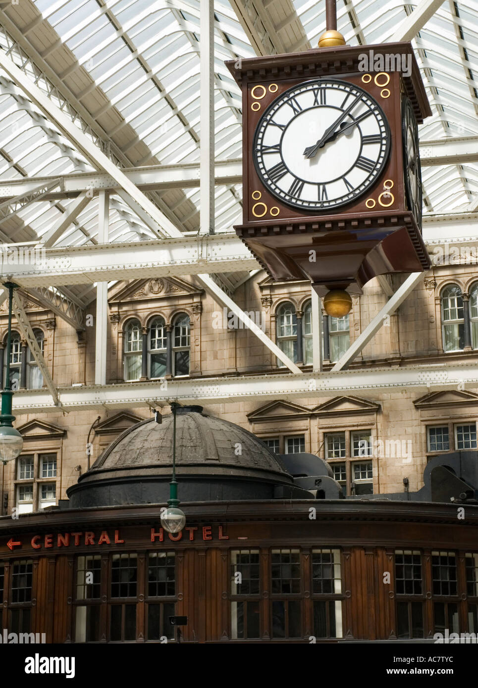 Ornate old clock inside Central railway station with Central Hotel to rear in Glasgow Scotland - Stock Image