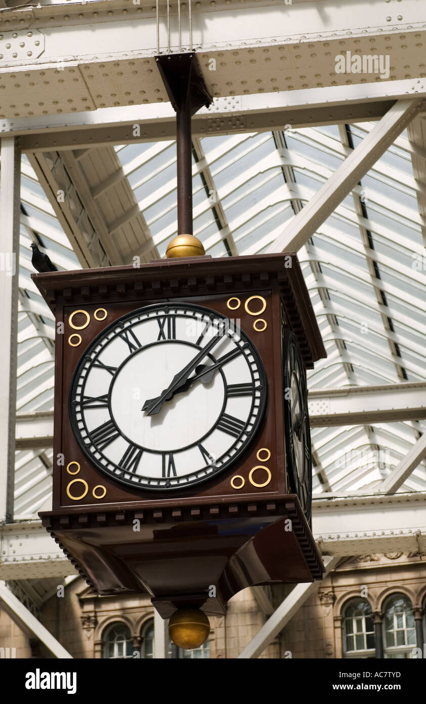 Ornate old clock inside Central railway station in Glasgow Scotland - Stock Image