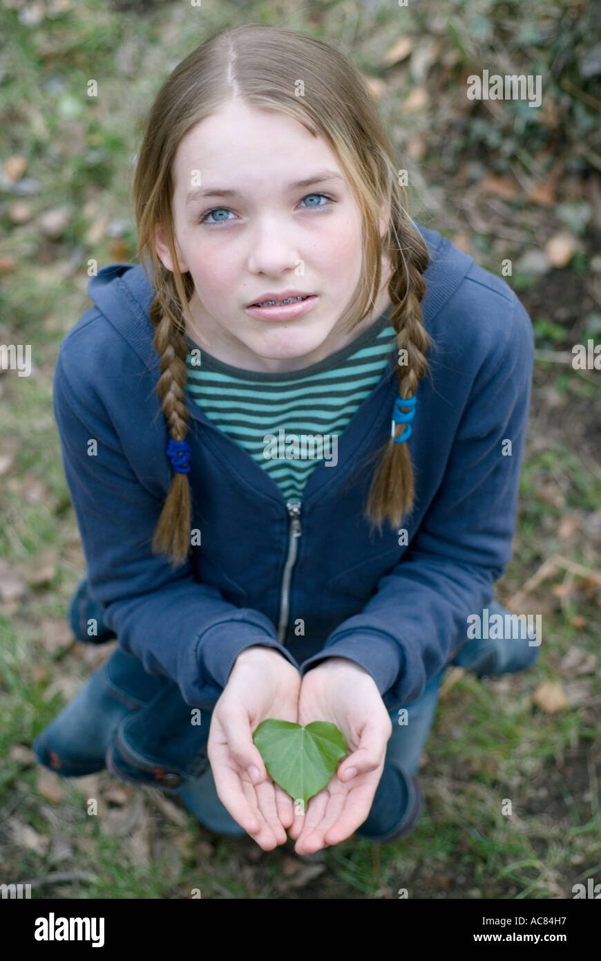 Portrait Of A 13 Year Old Girl With A Leaf In It S Hands