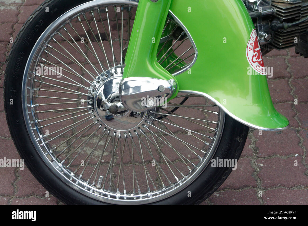 A classic motorcycle with spoked wheel - Stock Image