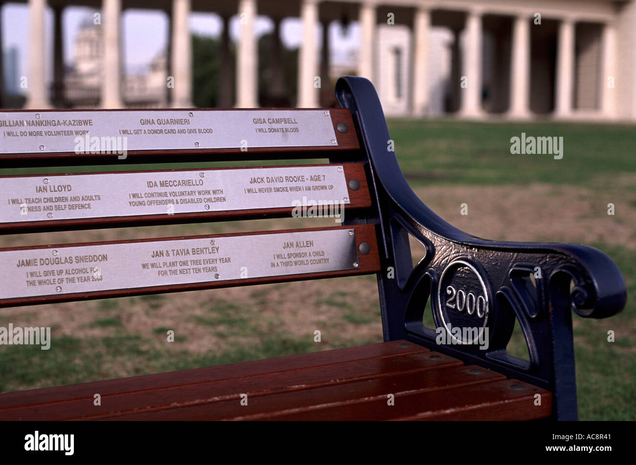 'I will volunteer to donate blood, teach children, never smoke, give up alcohol, ...' Year 2000 Promise Bench, Greenwich, UK - Stock Image