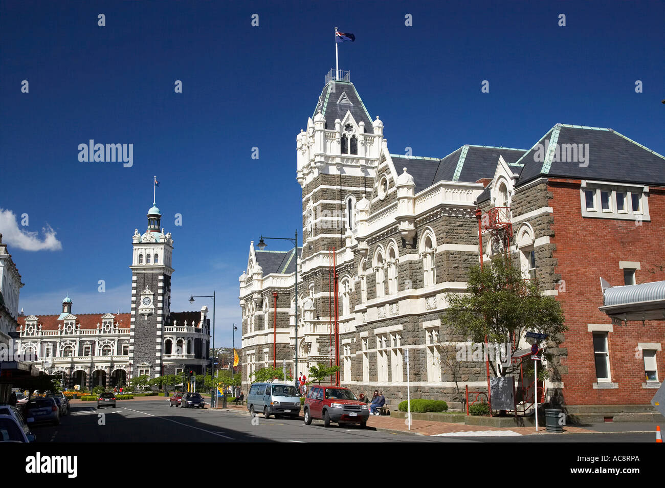 Historic Law Courts right and Railway Station left Dunedin South Island New Zealand Stock Photo