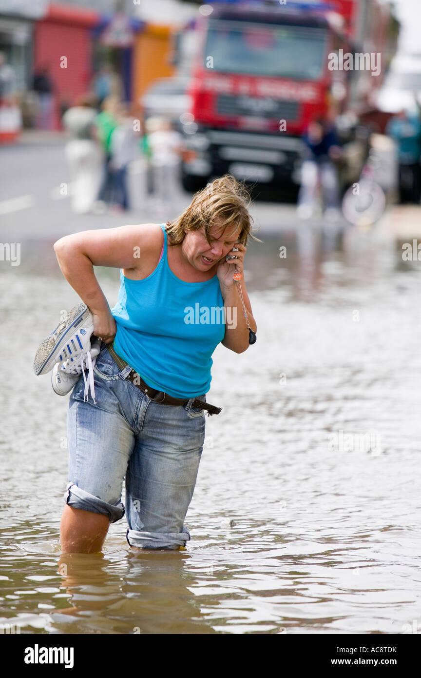 A women in the unprecedented June 2007 floods in Bentley, Doncaster, UK - Stock Image