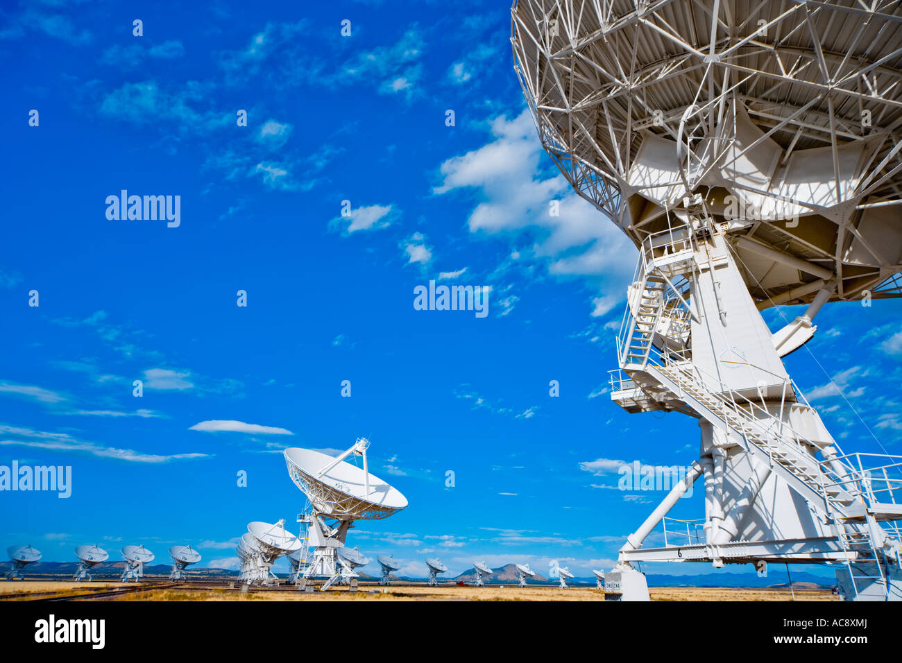 Satellite dishes dish of radio telescope astronomy observatory Very Large Array VLA near Socorro New Mexico US USA - Stock Image