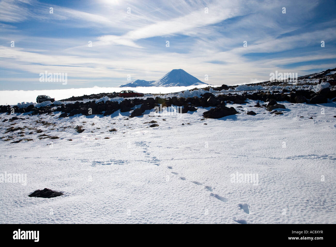 Footsteps in Snow and Mt Ngauruhoe Tongariro National Park Central Plateau North Island New Zealand - Stock Image