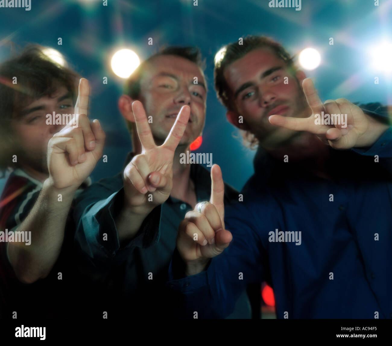 three males gesturing - Stock Image