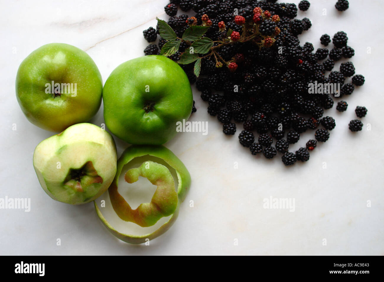 Hand picked apples and blackberries from the garden for fresh, tasty home baked pies Stock Photo