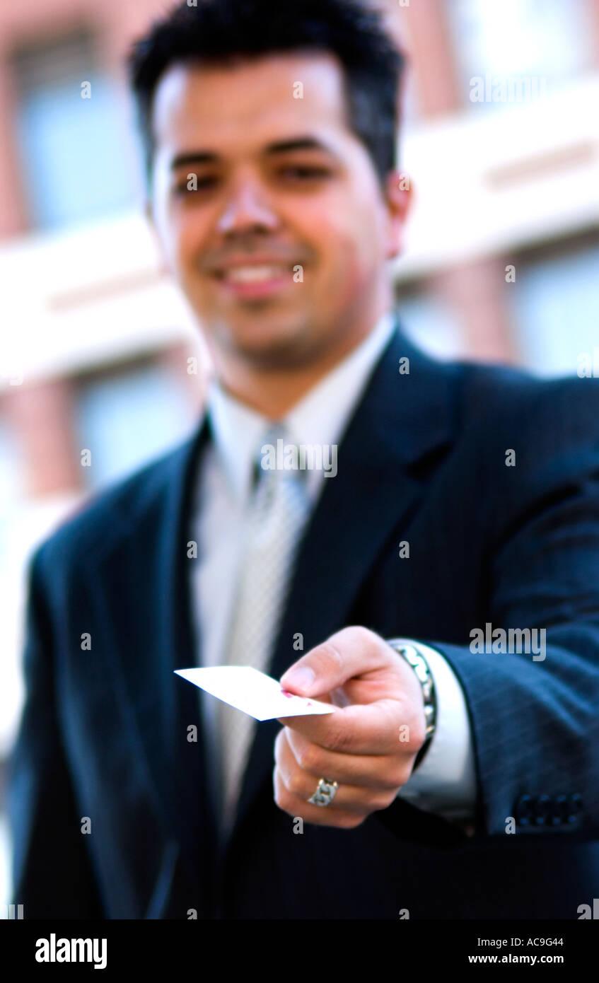 Businessman handing out business card stock photo 4271171 alamy businessman handing out business card colourmoves