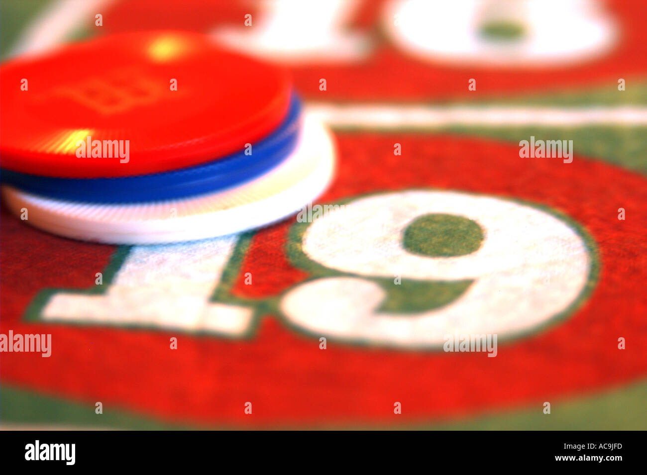 Bet on number nineteen of roulette table - Stock Image