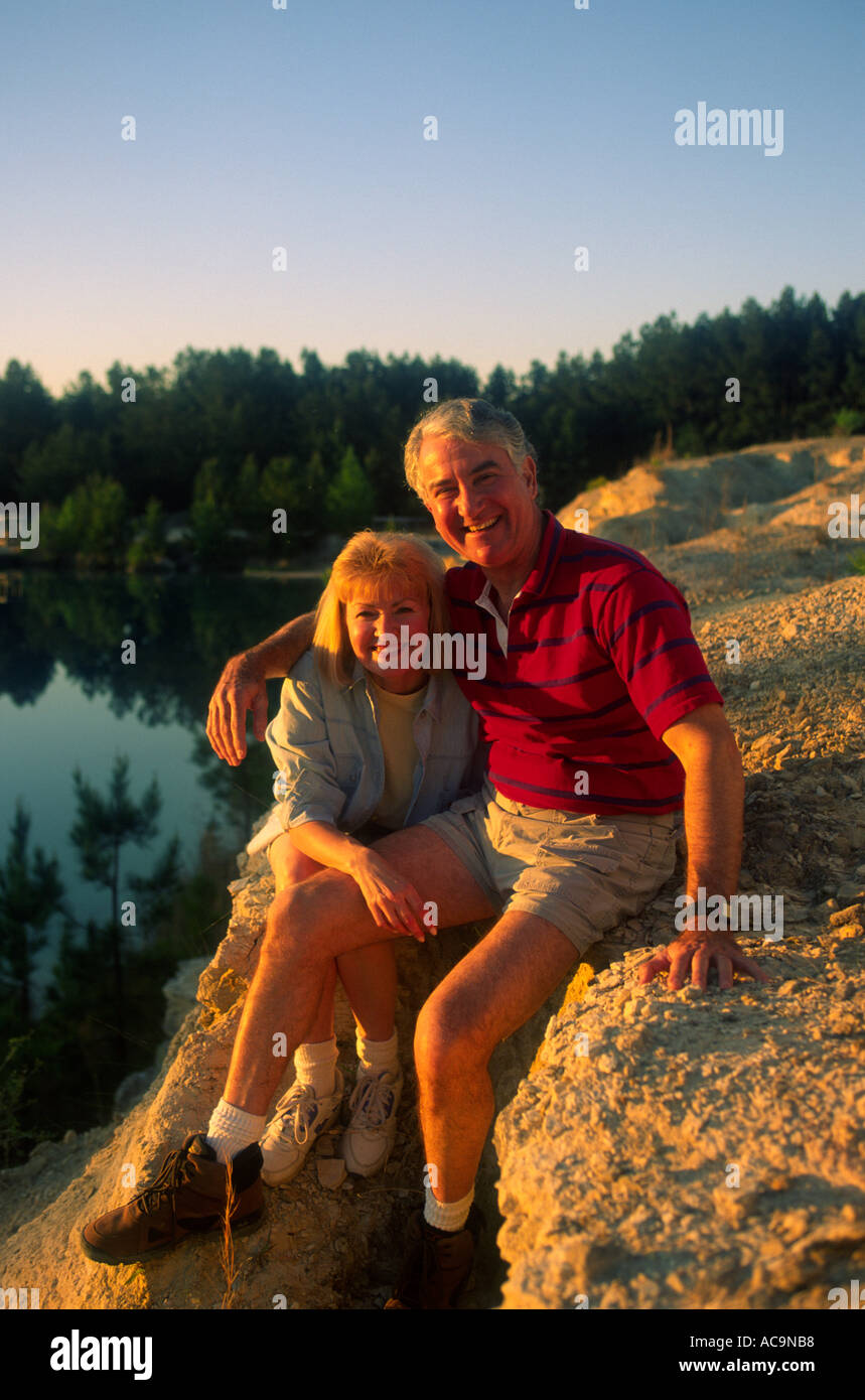 After a day of strenuous rock climbing and hiking a retired couple pose for the camera fitness fit - Stock Image