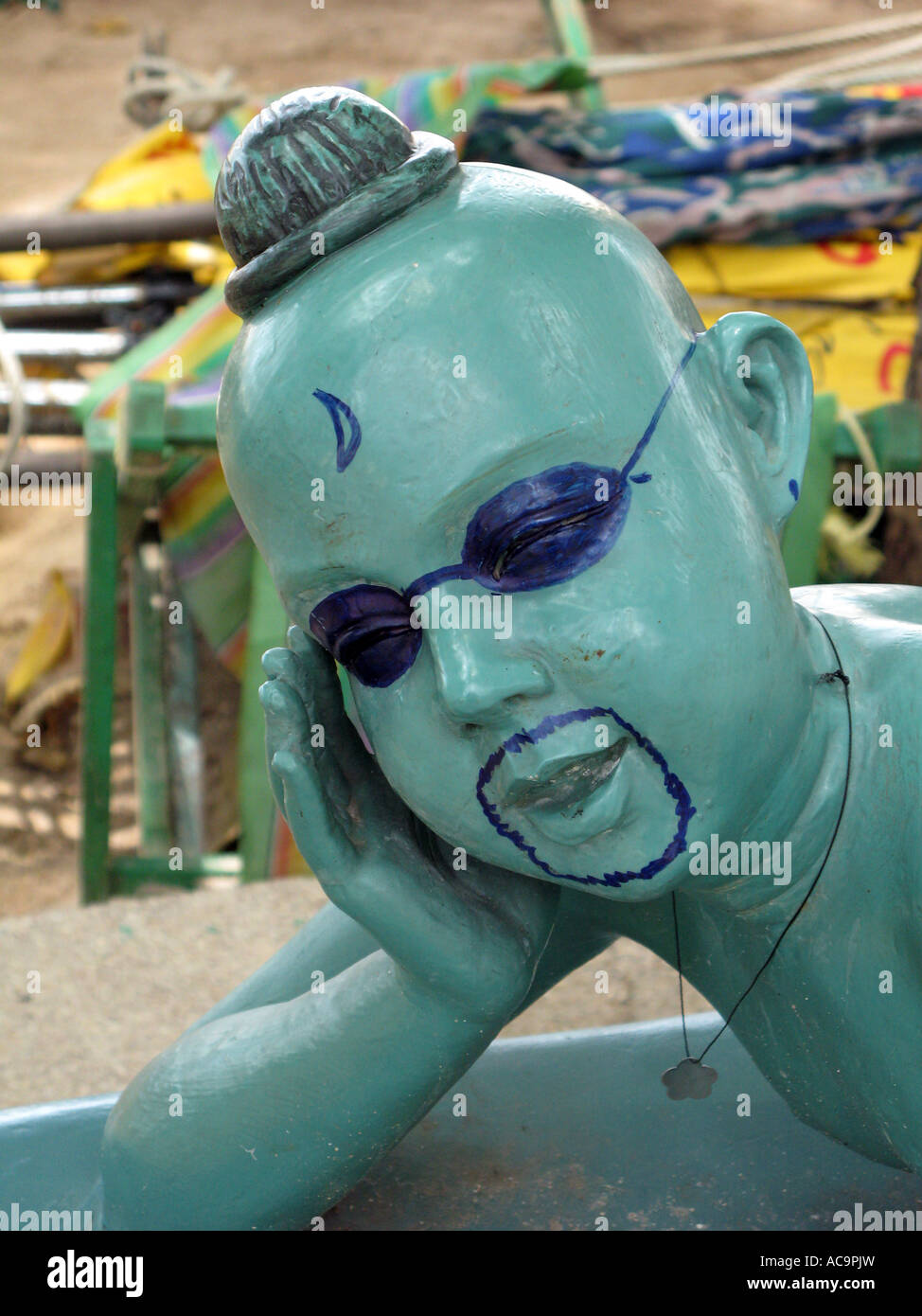 'defaced sculpture in Pattaya Thailand' - Stock Image