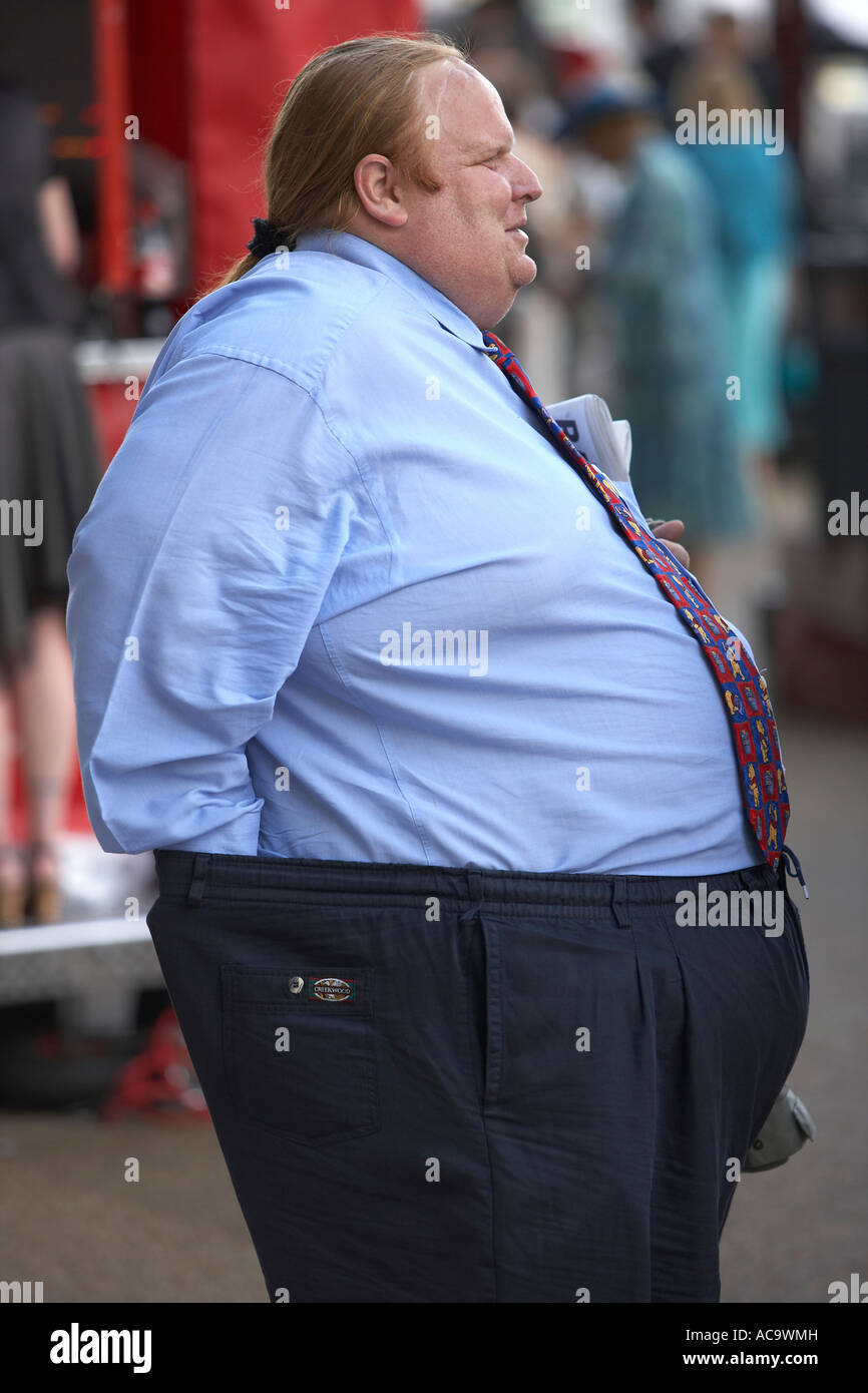 Fat Man with a Pony Tail at the Races - Stock Image