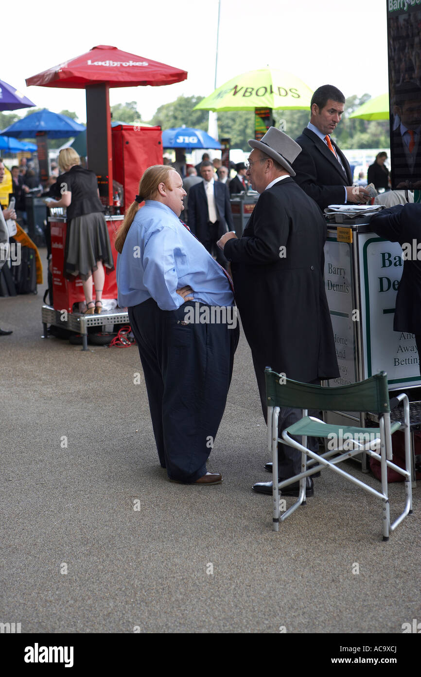 Fat Man with a Pony Tail at Royal Ascot talking to Barry Bismarck Dennis - Stock Image