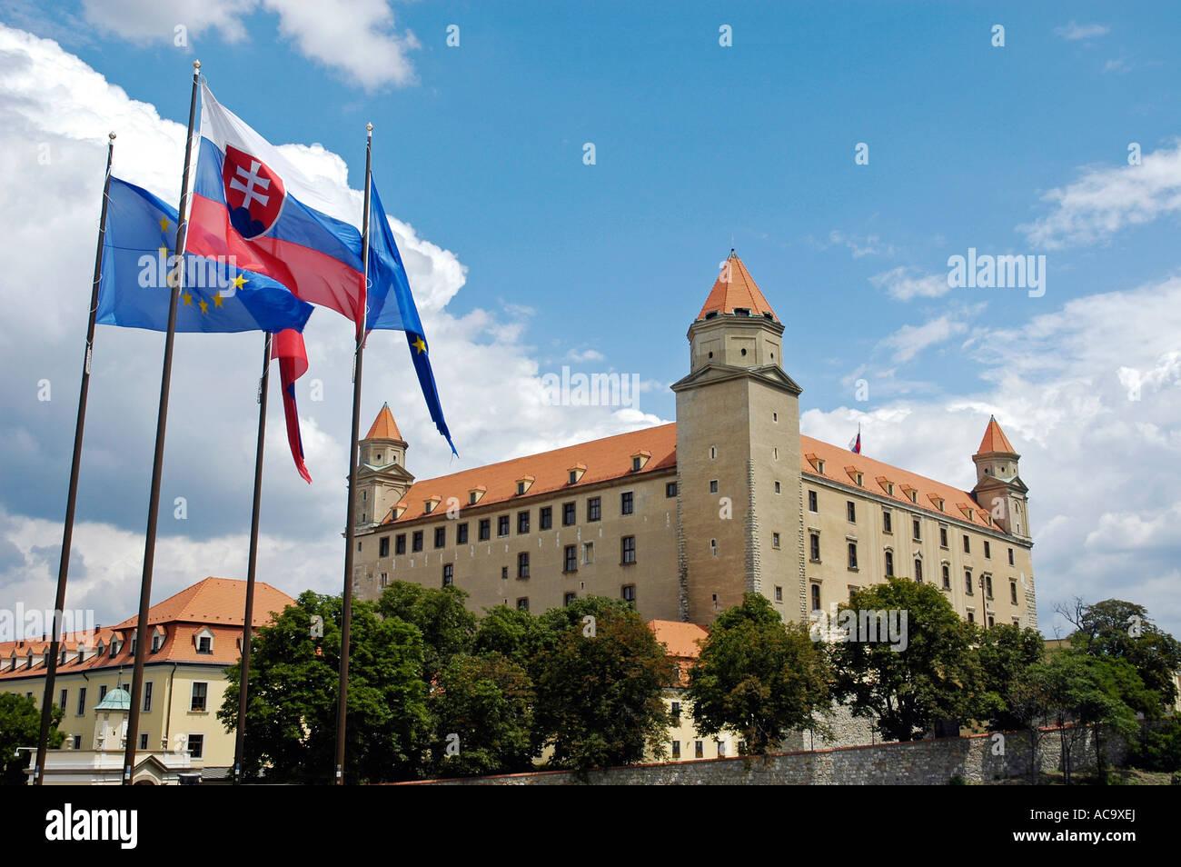 Slovak and European Union flags, Bratislava castle, Bratislava, Slovakia - Stock Image