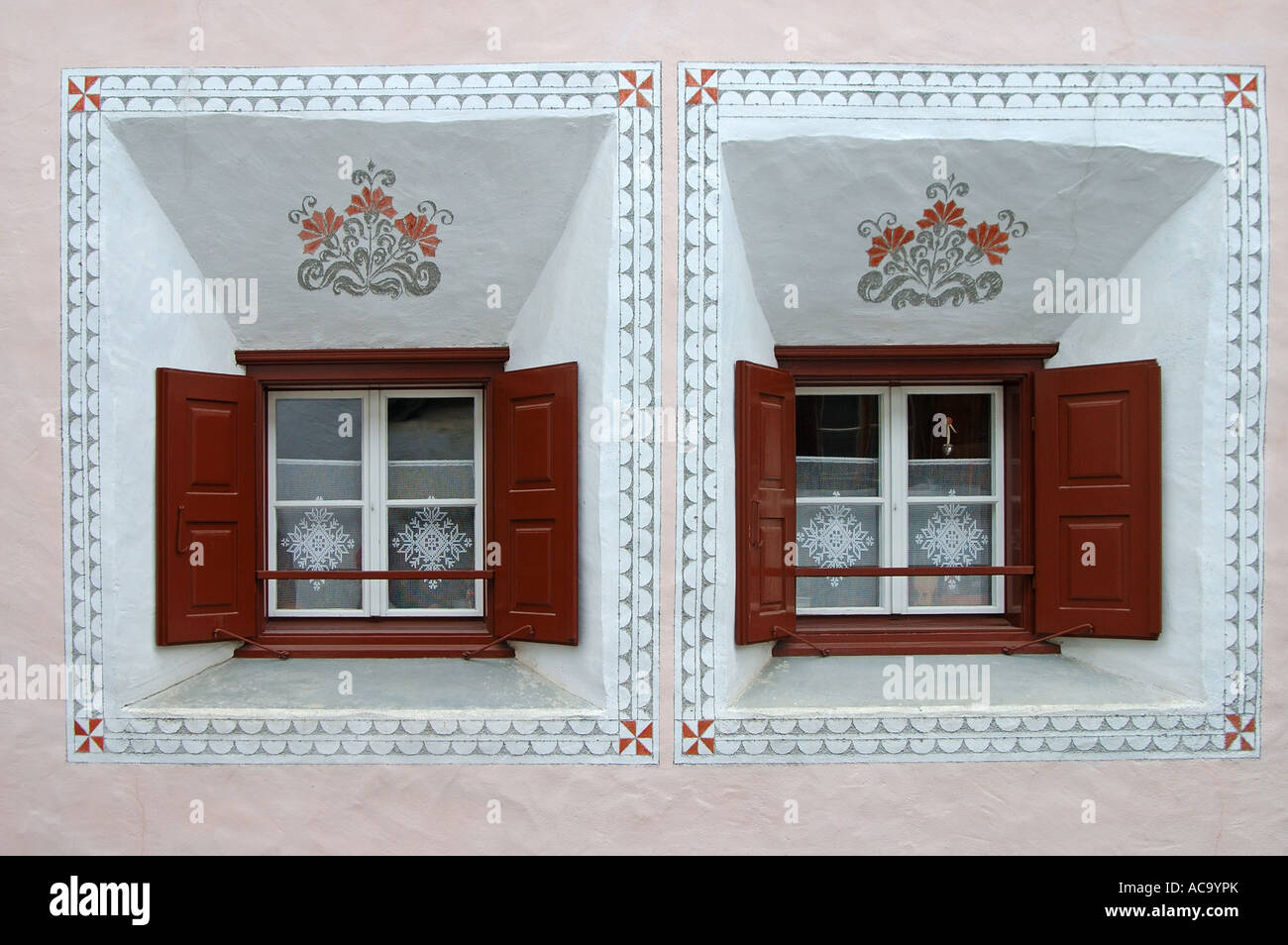 Windows of a typical Engadine house, Scuol, Engadin, Grisons, Switzerland Stock Photo