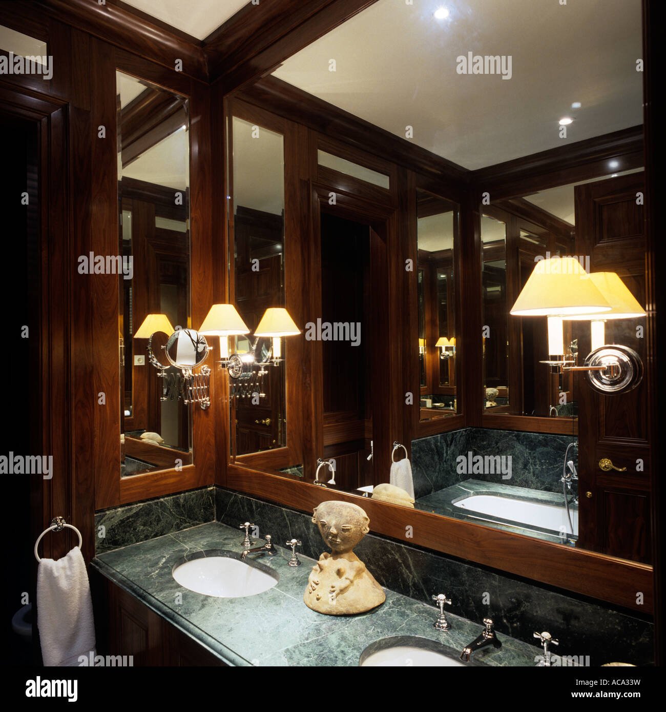 Double basin set in marble unit with wood framed mirror panels - Stock Image