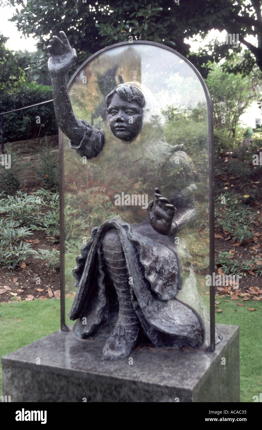 Life size statue of Alice Through the Looking Glass created by sculptress Jeanne Argent & displayed in the grounds of Guildford Castle - Stock Image