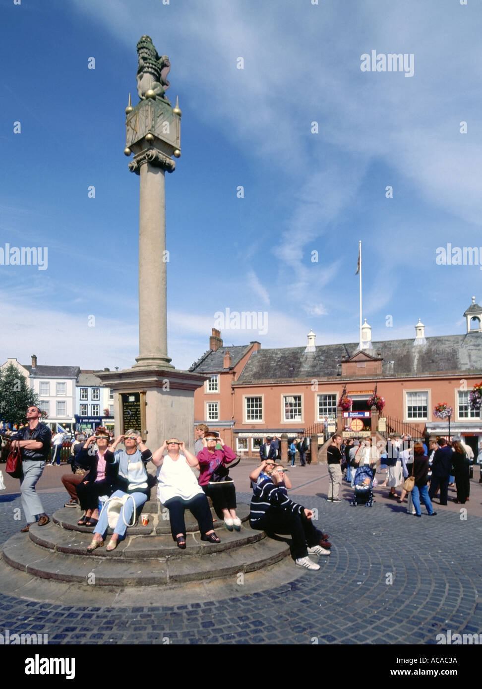 Carlisle town cross with sundial people watching partial eclipse of the sun on eleventh August 1999 - Stock Image