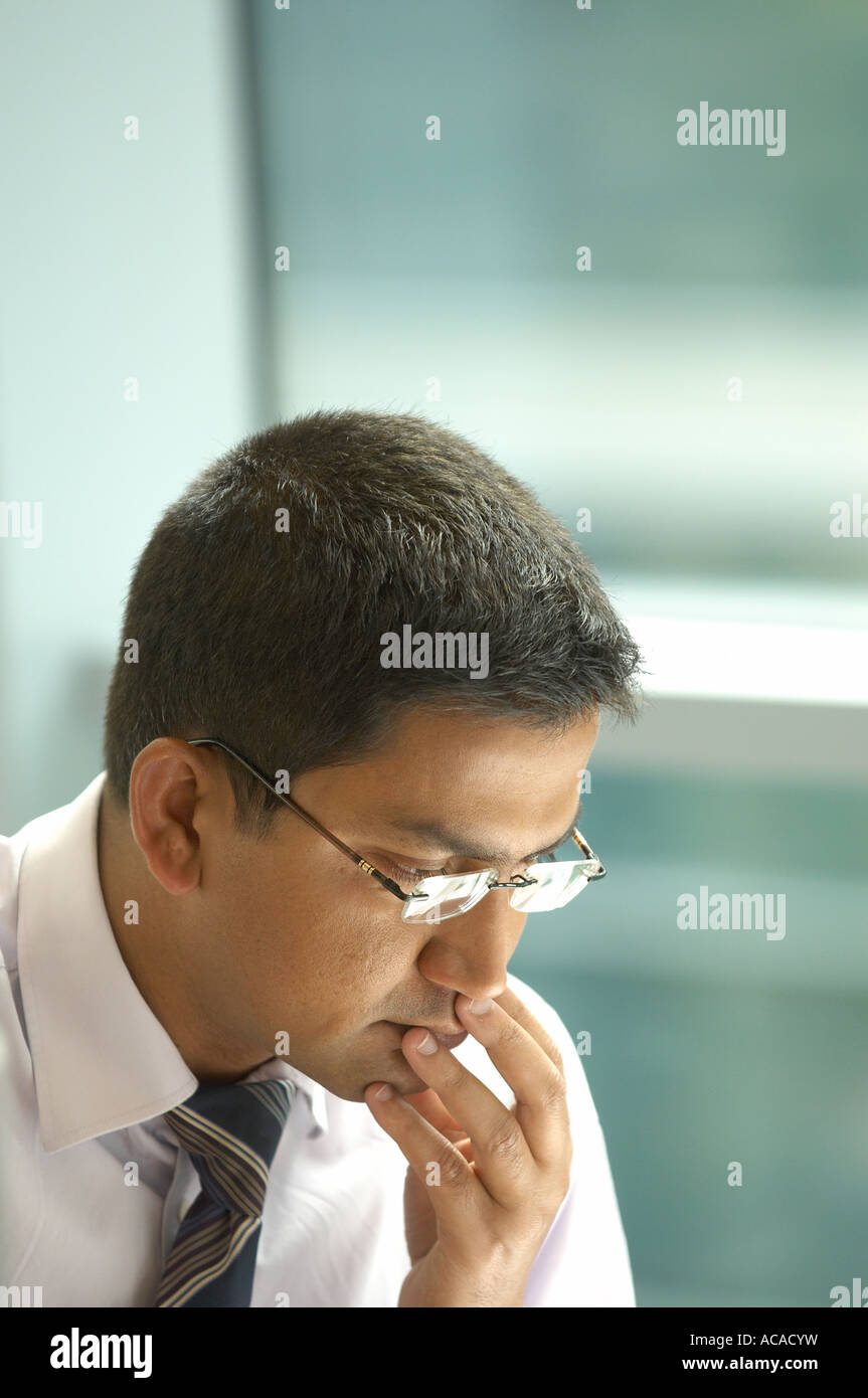 man concentrating - Stock Image