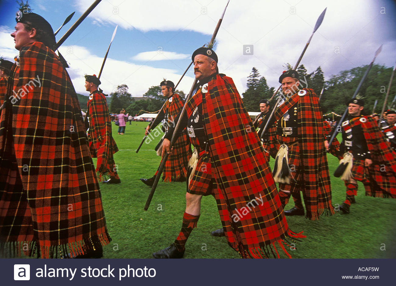 THE LONACH HIGHLANDERS MARCH AROUND THE GAMES FIELD AT THE LONACH HIGHLAND GAMES STRATHDON ABERDEENSHIRE - Stock Image