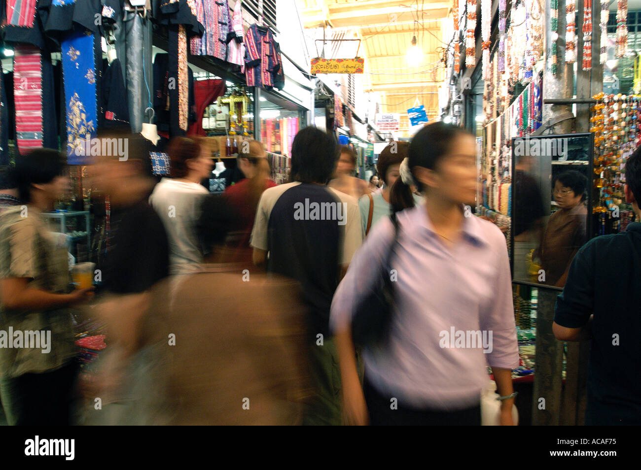 Busy alleyway between shops in Chatuchak Market in Bangkok Thailand - Stock Image