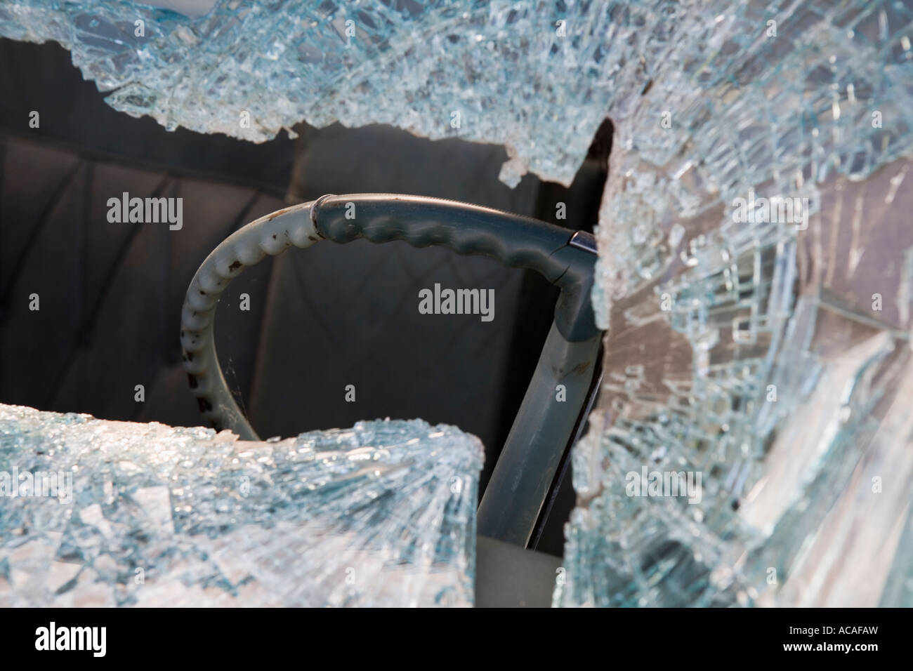 Aftermath of an automobile accident fatality shattered glass windshield - Stock Image