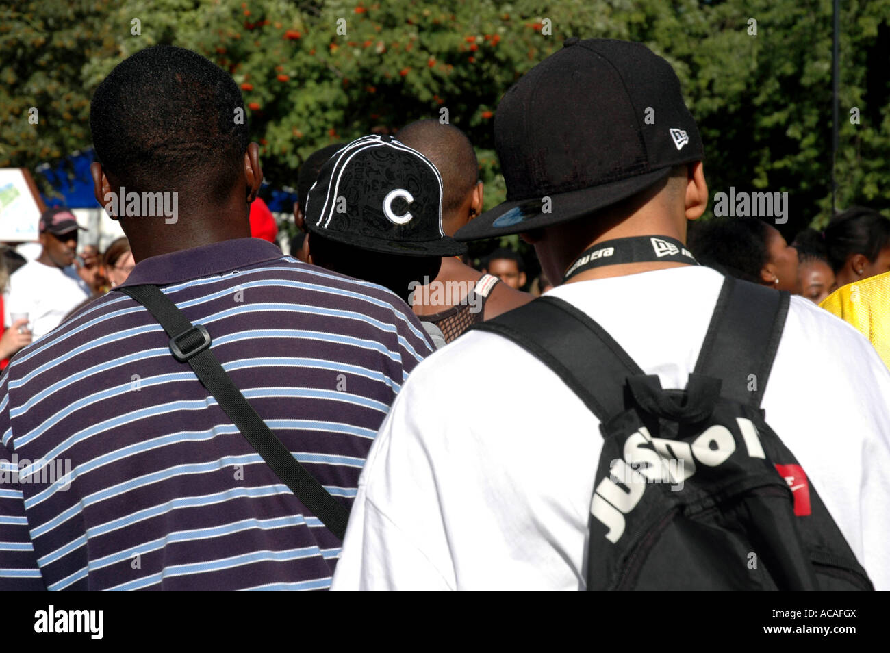 Back view of gang of lads in West London. - Stock Image