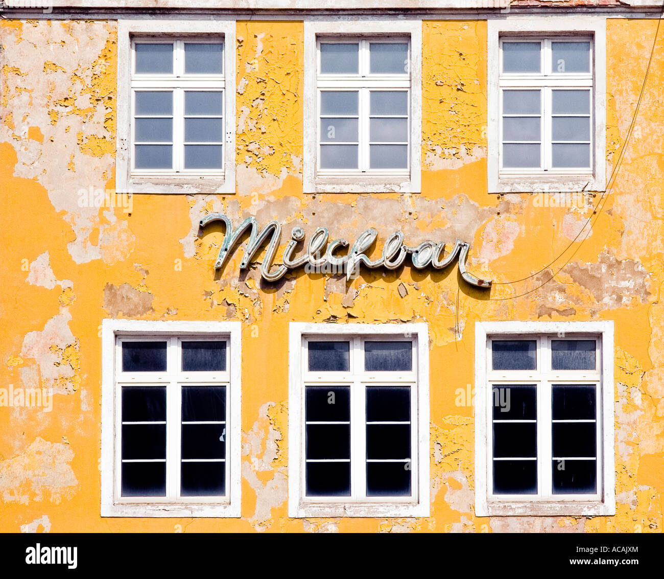 Old writing (Milchbar - milk bar) on the wall of a house in Stralsund, Mecklenburg-Western Pomerania, Germany - Stock Image