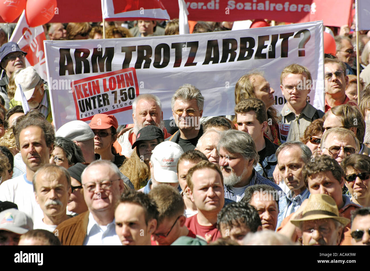 Transparant 'Poor in spite of work? No wage below 7.50 Euro per hour.' 1. Mai - Trade Union - DGB demonstration. - Stock Image