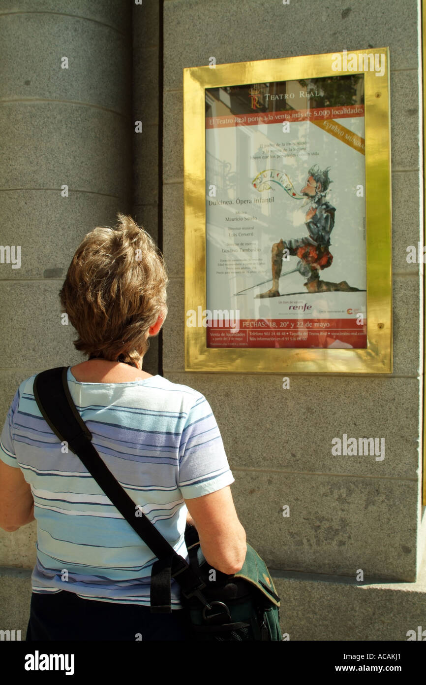 Theatre Real visitor reads programme. Madrid Spain Europe EU - Stock Image
