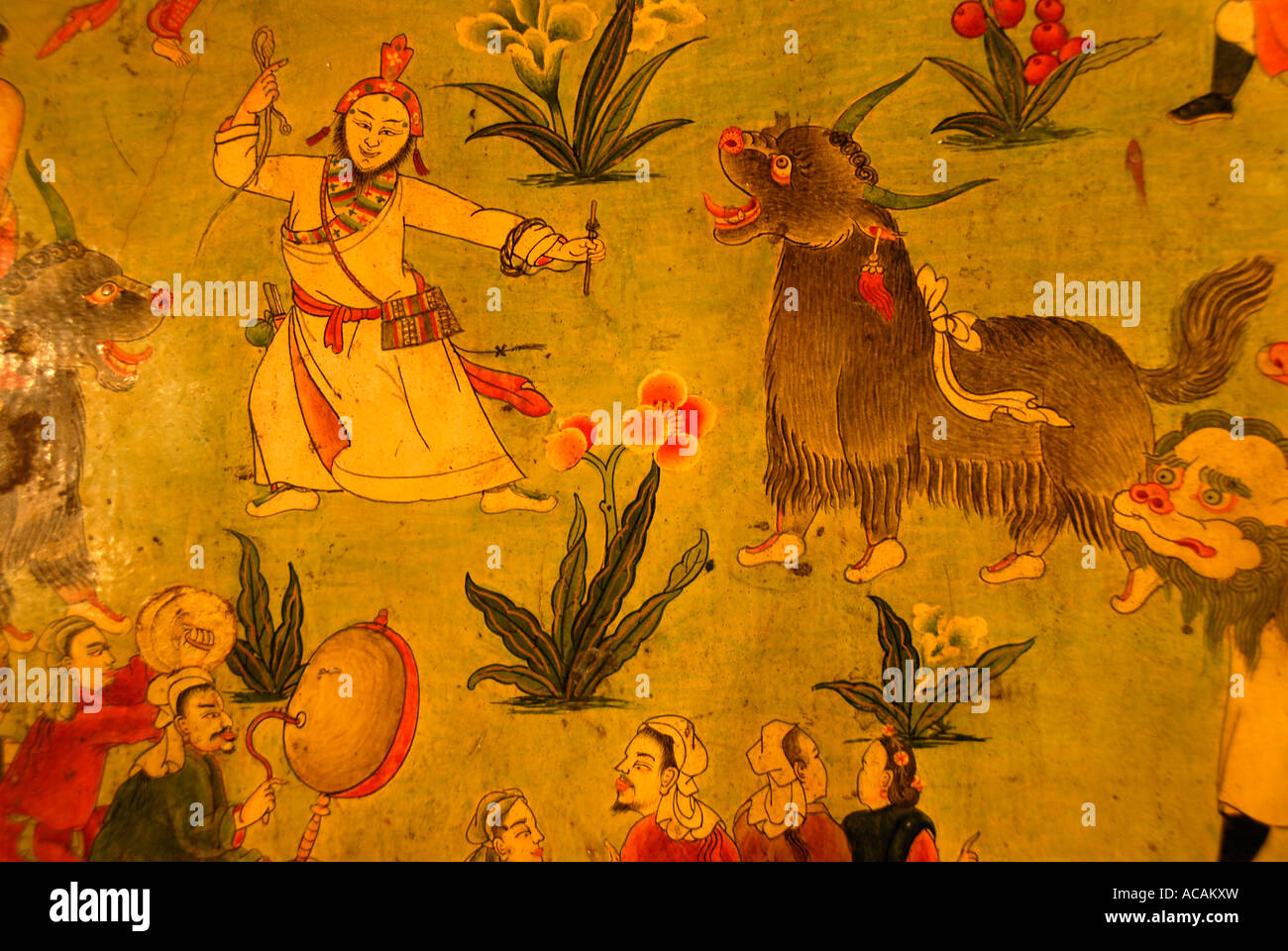 Tibetan Buddhism naive wall painting man with yaks Jokhang Lhasa Tibet China - Stock Image